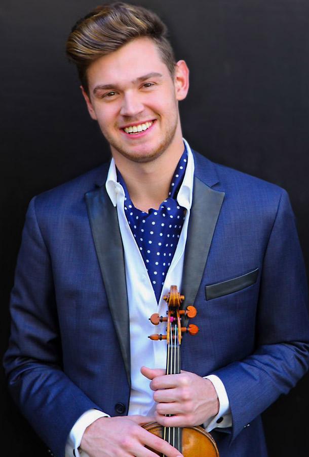 Blake Pouliot,head shot holding violin
