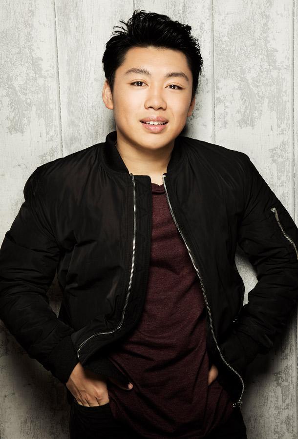 George Li Headshot. wearing maroon shirt and black jacket