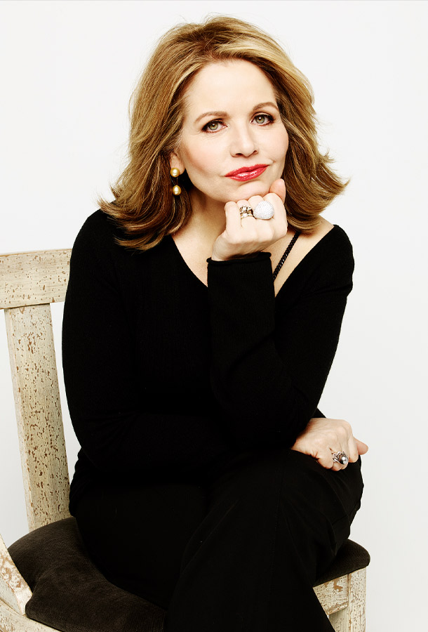 Renee Fleming posing in chair