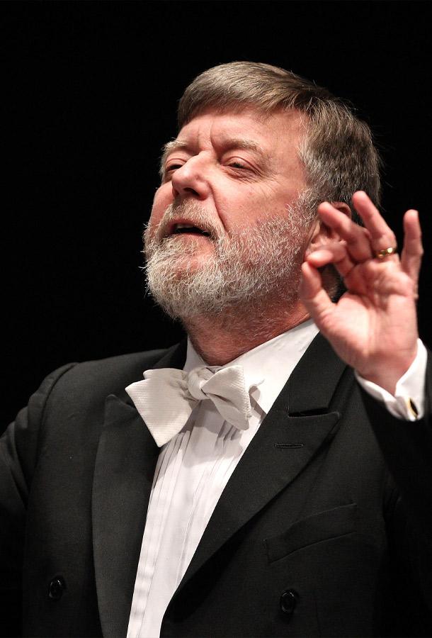 Sir Andrew Davis, conducting in tuxedo