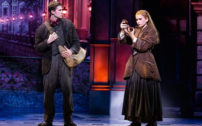 Dmitry and Anya looking at a music box