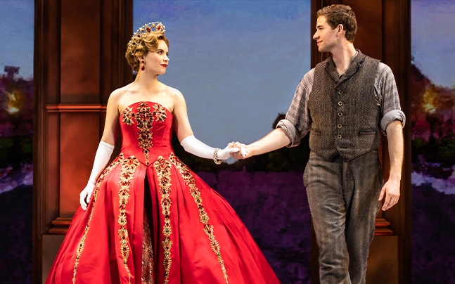 Anya dressed in a red royal gown, holding Dmitry's hand