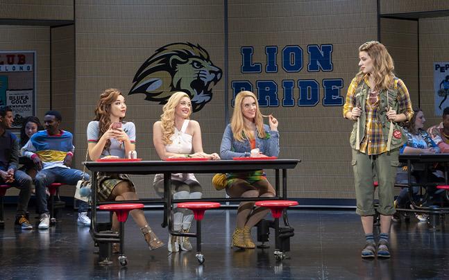 Gretchen Wieners, Regina George, Karen Smith, and Cady Herron in the cafeteria.