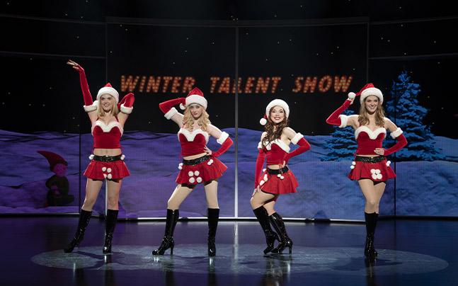 Karen, Regina, Gretchen, and Cady performing Jingle Bell rock in the school's talent show