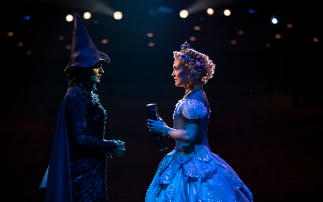Elphaba and Glinda looking at each other intently