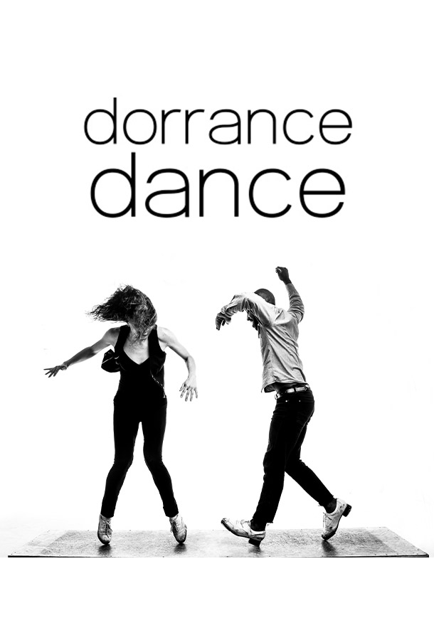 Dorrance Dance cast members tap dancing in black and white photo.