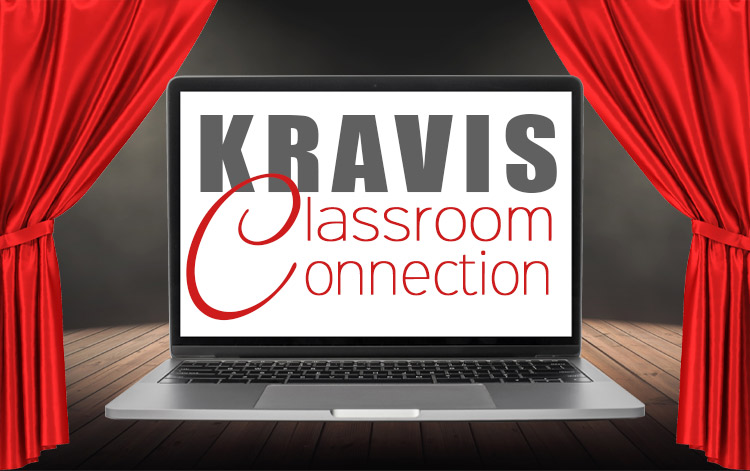 Kravis Classroom Connection being shown on laptop near red curtains.