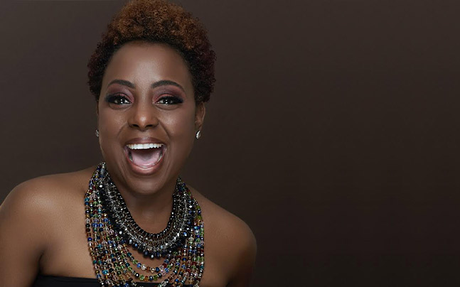 Ledisi headshot wearing a multicolored and multi-strand beaded necklace.