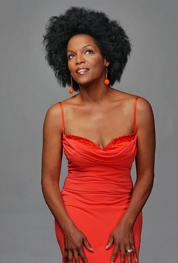 Nnenna Freelon posing in red dress.
