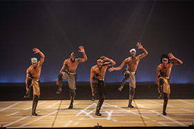 Step Afrika dance troupe on stage.
