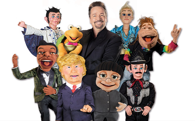 Headshot of Terry Fator and eight puppets