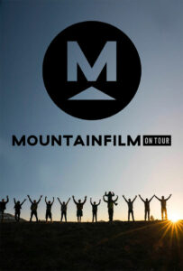 A group of men and women on the mountains raise their hands to the sky at dawn. Texts reads Mountainfilm