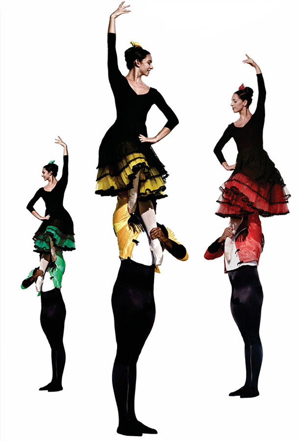 Three female dancers being held in the air with a sing arm raised and the other on their hips. They each are dressed in black with differing green, yellow, and red underskirts.