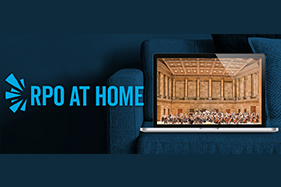 RPO at Home. Laptop screen showing orchestra hall