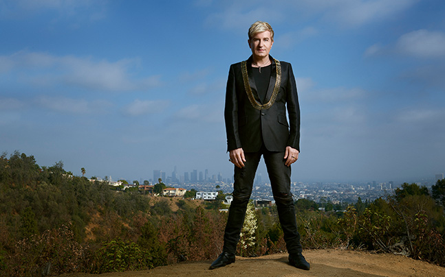 Jean-Yves Thibaudet posed outside with major city in far background
