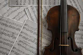 sheet music next to violin