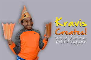 Kravis Creates! Virtual Summer Arts Program. Kid smiling with fish hat and hands.