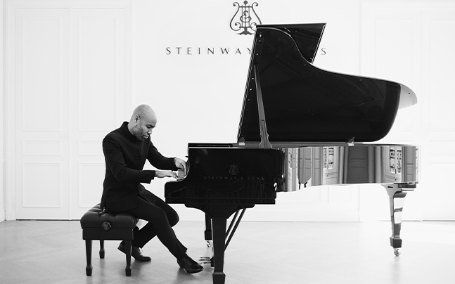 Aaron Diehl playing on piano.