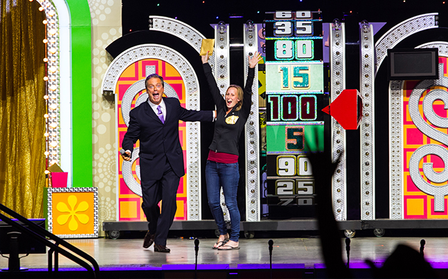 The Price is Right Live spin wheel, women winning at wheel.