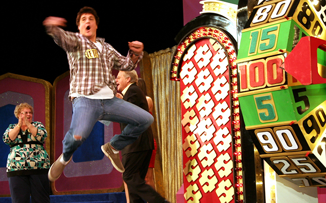 The Price is Right Live spin wheel, man jumping.
