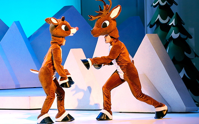 - 2 people in reindeer suits talking to each other