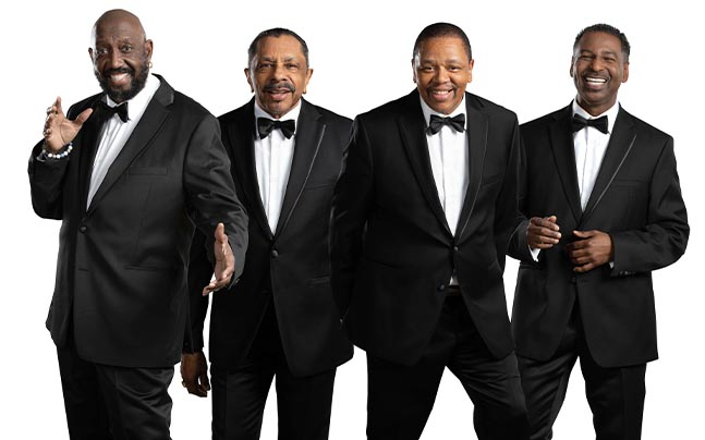 Temptations band members pose in tuxedoes
