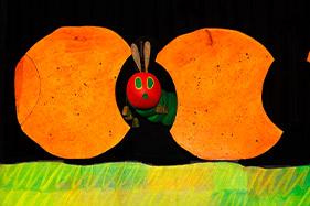 The hungry caterpillar looking through bitten fruit