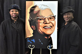 Two actresses next to painting of Rosa Parks