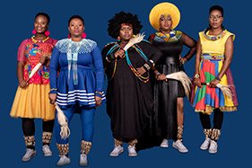 5 women in traditional African dress