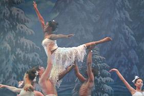 Dancer in pose being held in mid air